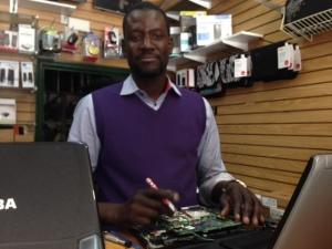 Mandoye Ndiaye runs Afrik PC, a computer repair shop.